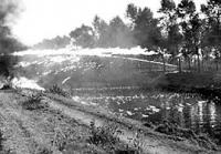 WASP flamethrowers of 2nd Cdn Inf Div bathe German defences on the Leoplod Canal 6 Oct 1944