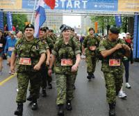 MCpl Justin Pike (left), MCpl Angela Abbey and Capt David Tischhauser, members of the Nijmegen National Capital Region Team Two, during the Ottawa Marathon, held May 29. The team did the 42 km marathon march as part of their work-up training for the upcoming Nijmegen Marches.