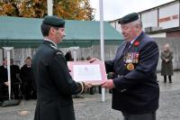 MWO Jim Harris, MMM, CD (Ret'd) receives his certificate from Gen Benjamin
