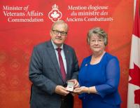 Minister of Veterans Affairs presents his commenation medal to Shirley O'Connell
