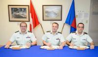 BGen A.R. Jayne, CD (Outgoing Branch Advisor), MGen J.S. Sirois, OMM, CD (CAF Chief Military Engineer), Col M. Gros-Jean, CD (Incoming Branch Advisor) signing the Branch Advisor change of appointment certificate
