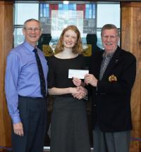 LCol Ralph Gienow (ret'd) presents a cheque to Valerie Moore with her father, CMEA member Maj T.A.P.Moore (Ret'd), standing by.