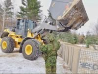Photo 2 Combat Engineers soldiers fill hesco barriers at a Vehicle Inspection Point du ring Ex MATTAWA SAPPER, Nov 18