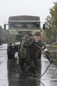 Cpl Deny Cassista (Team 2) pulling a Spanish military vehicle