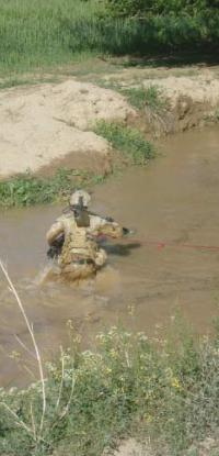 Sapper crossing a wadi to clear the other side before the convoy drives through.